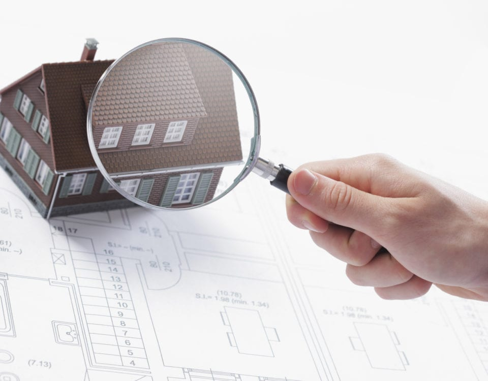 Magnifying glass and house.